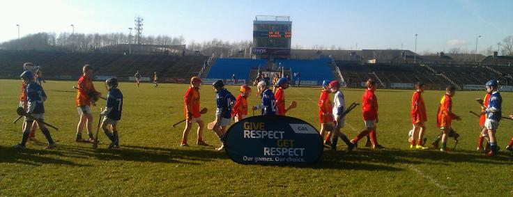 The Castlebar Mitchels and Claremorris sides demonstrate the 'Respect Initiative' protocol after their recent U13 Hurling Supertouch Exhibition game in McHale Park, while the Roscommon and Mayo sides get ready to commence the second half of their NHL tie.