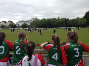 Backstage: The Mayo Cumann na mBunscol Girls watching the Mayo senior team warm up before thier clash with Galway.