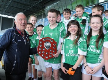 Jimmy Connor chairman, presenting Dylan Carney Capt of Derrinabroc N.S. with the Div 3 Plaque at the Cumann na mBunscol hurling finals in Mc Hale Park. Picture; Frank Dolan